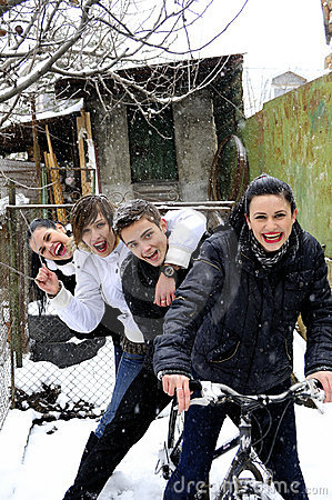 Teens on bicycle in winter season