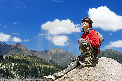 Teens boy in mountains hike