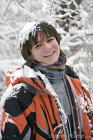 Teens boy in scarf  outdoors in winter