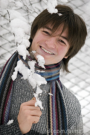 Teens boy with snown branch
