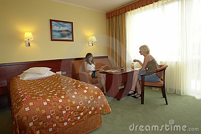 Teens chatting in hotel room
