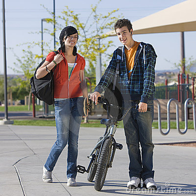 Teens couple walks together