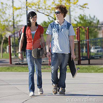 Teens couple walks together