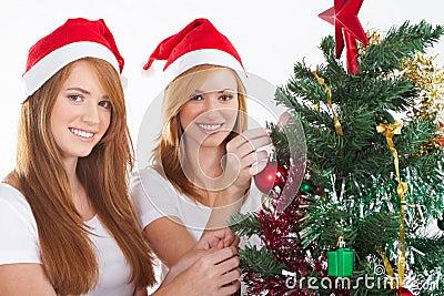 Teens decorating christmas tree