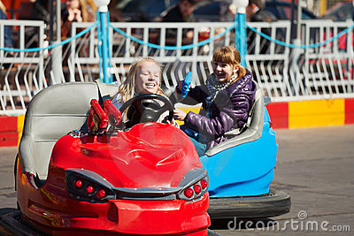 Young girls driving a bumper cars