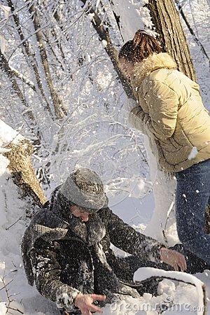 Teens fighting with snow balls