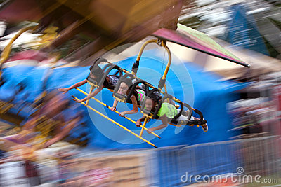 Teens On A Flying Carnival Ride Motion Blur Editorial Stock Photo