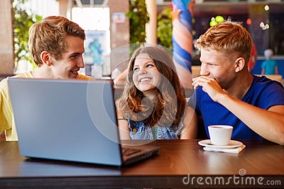Teens friends spend time together in cafe