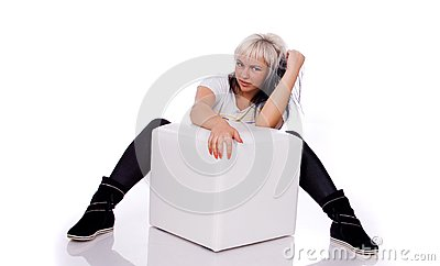 Teens - girl sitting behind the ottoman