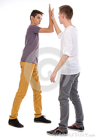 Teens giving high five