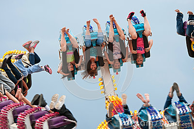 Teens Go Upside Down On Carnival Ride Editorial Stock Image
