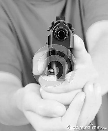 Teens hand with gun