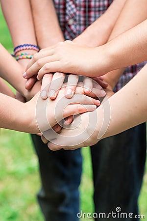 Teens  hands toghether