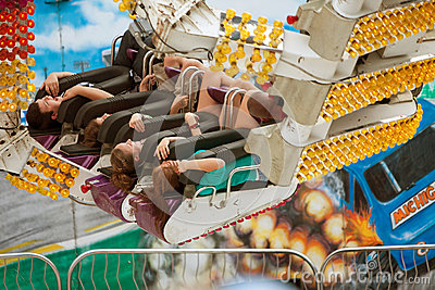 Teens Have Fun On Exciting Carnival Ride Editorial Stock Photo