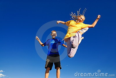 Teens jumping into the air