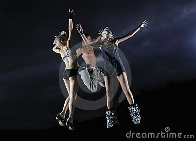 Teens jumping in air ready for party