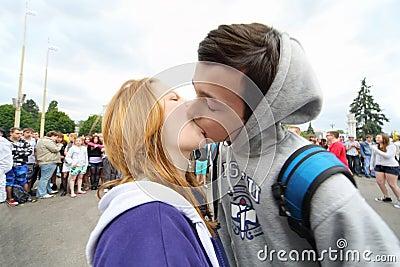 Teens kiss at water battle flashmob Editorial Stock Photo