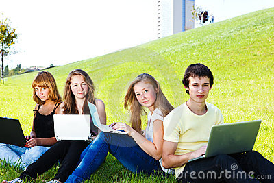 Teens with laptops