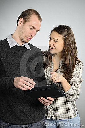 Teens learning from notebook