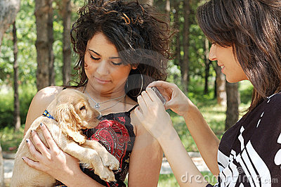 Teens with a little dog