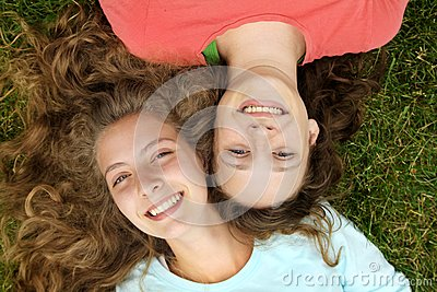 Teens lying in a grass