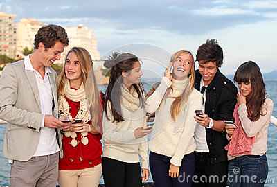 Teens with mobile or cell phones
