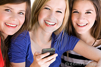 Teens with mobile phone
