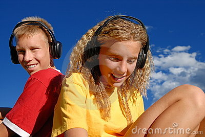 Teens with music headphones