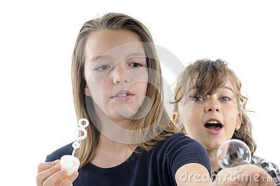 Teens  playing with shampoo bubbles