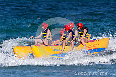 Teens Ride On Banana Boat Editorial Photo
