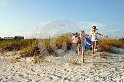 Teens running to the beach