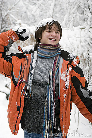 Teens  in scarf with snowball