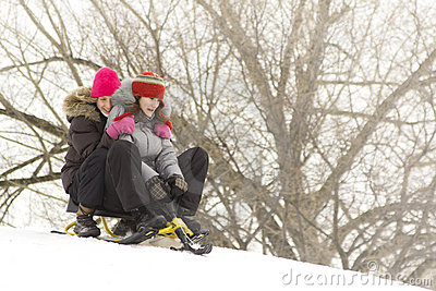 Teens sliding on three ski