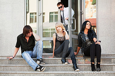 Teens on the steps.