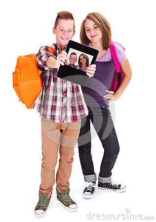 Teens taking self portrait with tablet PC