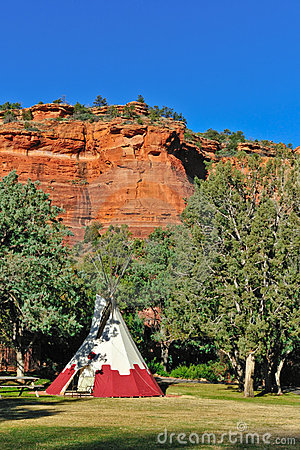 Teepee by trees and red rocks