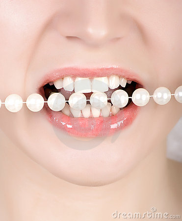Teeth biting on faux pearls