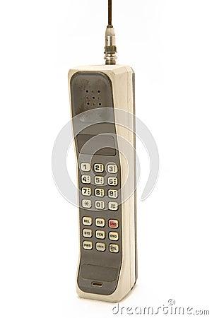 Teléfono móvil viejo y sucio aislado