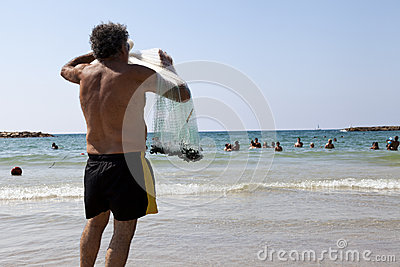 Fisherman Pulling Net on Tel-Aviv Beach Editorial Image