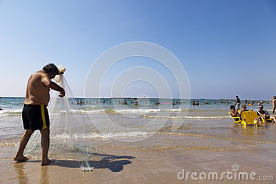 Fisherman Pulling Net on Tel-Aviv Beach Editorial Stock Image