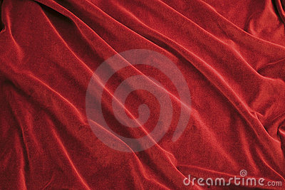 El terciopelo lujoso del rojo rico plegable la tela, útil para los ...
