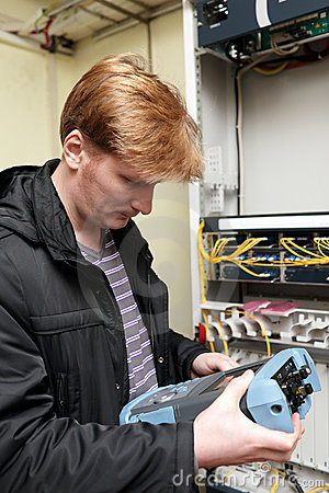 Telecom engineer looking at reflectometer