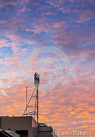 Telecom tower with  golden cloud