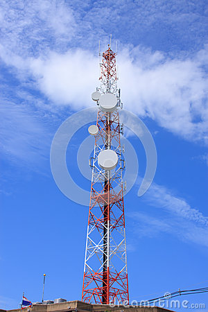 Telecommunications tower against blue sky