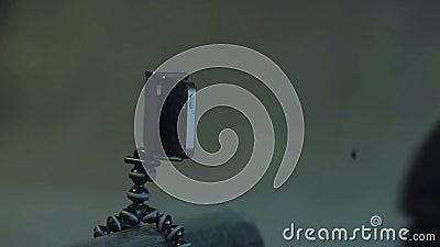 Telefoon op een driepoot stock footage