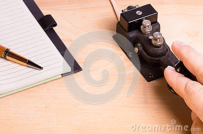 Telegraph key and notebook