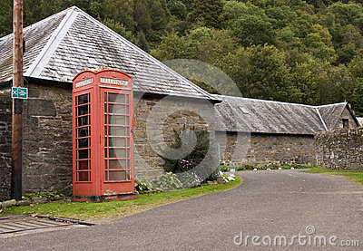 Telephone box by road