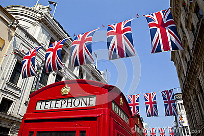 Telephone Box and Union Flags in London Editorial Image