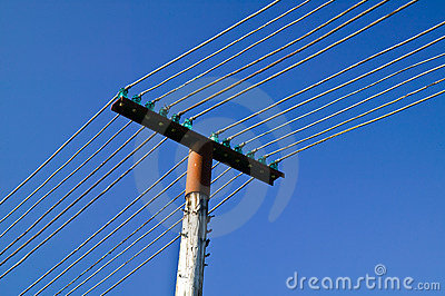 Telephone Poles and lines against a blue sky