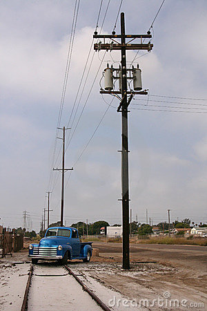 Telephone poles, train track, truck